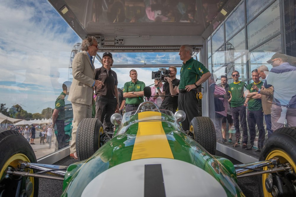 Duke of Richmond_Emerson Fittipaldi_Phil Popham_Clive Chapman Goodwood FOS Lotus Stand Visit - High Res-9.jpg